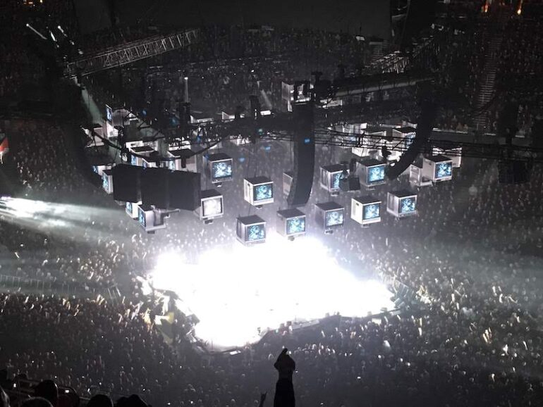 Concert stage with bright light and sound sensitivity to manage
