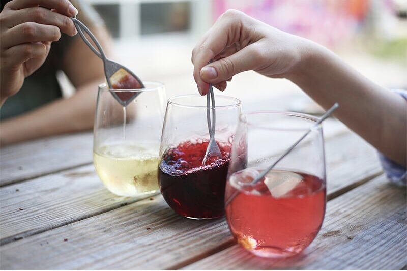 wine filled glasses using The Wand by PureWine to have wine without migraine
