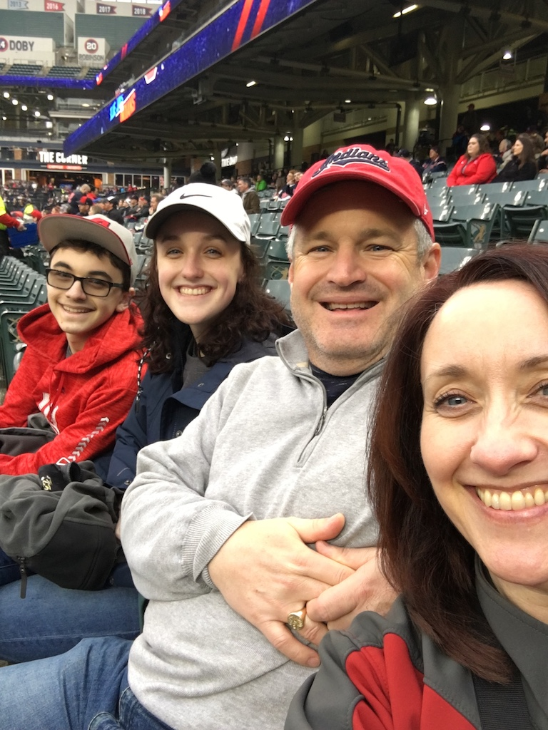 four people at a baseball practicing gratitude