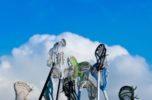 Migraine and sports Lacrosse sticks held high